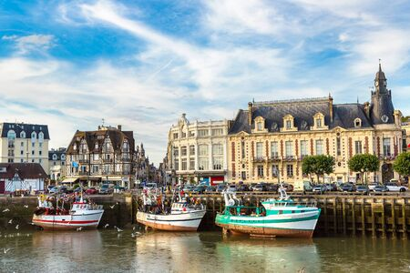 Trouville and Touques river and a lot of seagull in a beautiful summer day, France