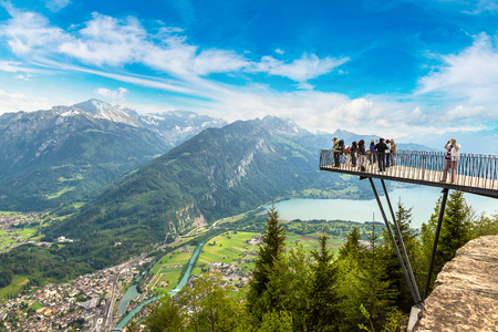 People standing on the observation deck in Interlaken in a beautiful summer day, Switzerland Stock Photo