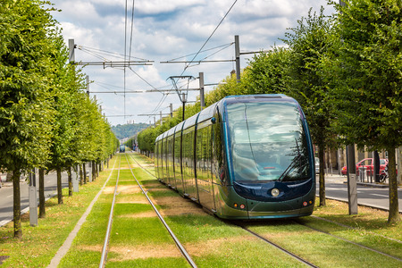 Modern city tram in Bordeaux in a beautiful summer day, France