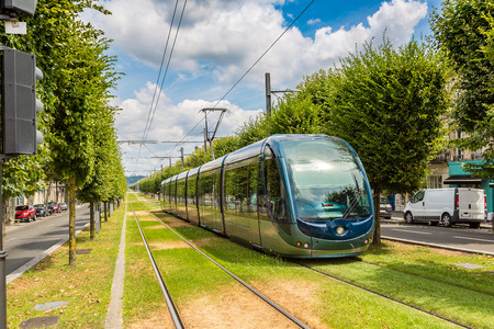 french way: Modern city tram in Bordeaux in a beautiful summer day, France