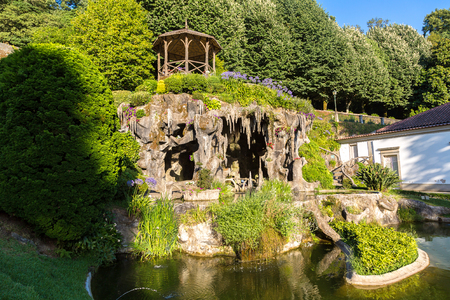 Cave in garden Bom Jesus do Monte Monastery in Braga in a beautiful summer day, Portugal