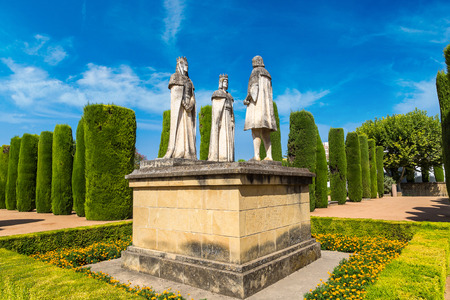 queen isabella: Statue of Christian kings Ferdinand and Isabella and Christopher Columbus in Alcazar de los Reyes Cristianos in Cordoba, Spain