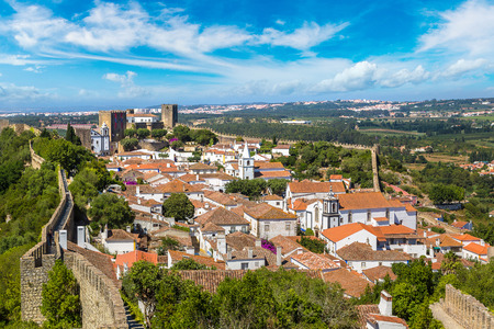 Panoramic aerial view of medieval town Obidos in a beautiful summer day, Portugal
