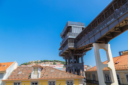baixa: Santa Justa lift built by Raoul Mesnard in 1902 in Lisbon in a beautiful summer day, Portugal