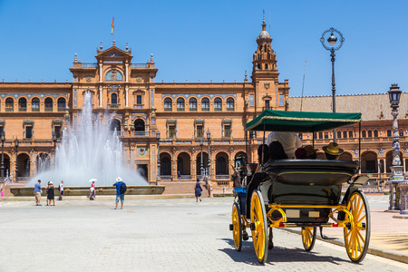Spanish Square (Plaza de Espana) and horse carriage in Sevilla in a beautiful summer day, Spain