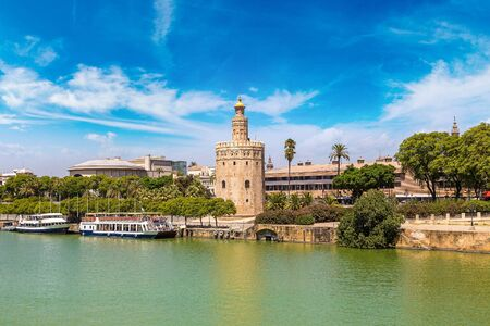 Golden tower (Torre del Oro) along the Guadalquivir river in Sevilla in a beautiful summer day, Spain
