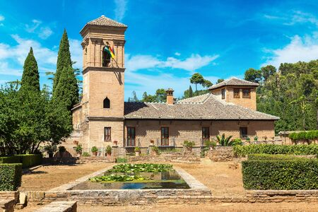 Garden and Bell Tower in Alhambra palace in Granada in a beautiful summer day, Spain