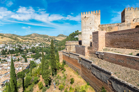 Nasrid palaces (Palacios Nazaries) and palace of Charles V in Alhambra palace in Granada in a beautiful summer day, Spain