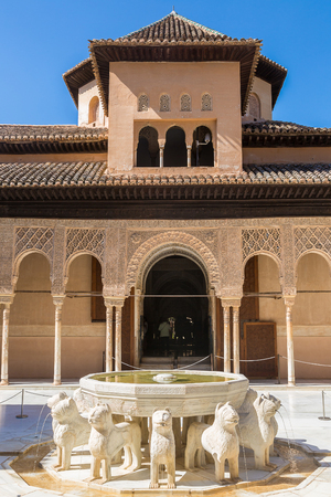 The Court of the Lions in Alhambra palace in Granada in a beautiful summer day, Spain