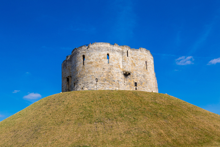 Cliffords Tower in York in North Yorkshire in a beautiful summer day, England, United Kingdom