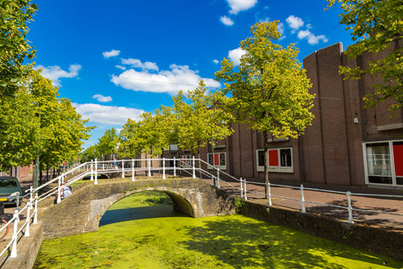 Canal in historical part of Delft in a beautiful summer day, The Netherlands