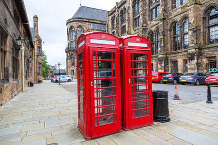 Red Telephone Booth in University of Glasgow, Scotland, United Kingdom Editorial