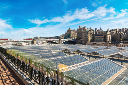 tourist site: Aerial view of Waverley railway station in Edinburgh in a beautiful summer day, Scotland, United Kingdom