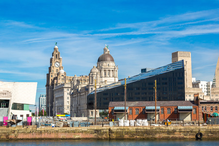 View of Albert Dock and Three Graces building in Liverpool in a beautiful summer day, England, United Kingdom Editorial
