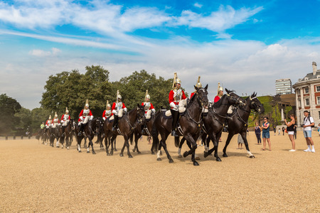 solider: LONDON, UNITED KINGDOM - JUNE 14, 2016: Royal Guards parade at the Admiralty House in London, England, United Kingdom on June 14, 2016