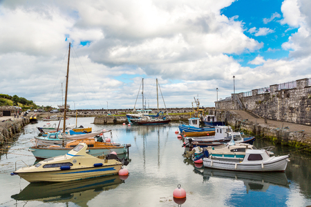 Small port in Carnlouhg town in a beautiful summer day, Northern Ireland, United Kingdom