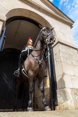 solider: LONDON, UNITED KINGDOM - JUNE 14, 2016: Royal Horse Guards at the Admiralty House in London, England, United Kingdom on June 14, 2016