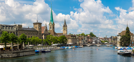 Panorama of Historical part of Zurich with famous Fraumunster and Grossmunster churches in a beautiful summer day, Switzerland Stock Photo