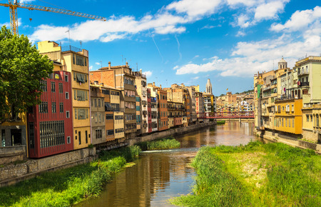 metalic: Colorful houses, Eiffel bridge and Saint Mary Cathedral at background in Girona, in a beautiful summer day, Catalonia, Spain