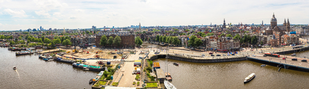 Panorama of Canal and St. Nicolas Church in Amsterdam in a beautiful summer day, The Netherlands Stock Photo