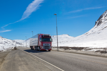 Winter landscape and truck in Norway in a sunny day