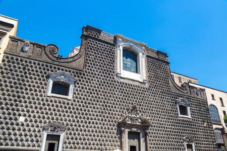 New Jesus church (Gesu Nuovo) in Napoli, Italy in a beautiful summer day Фото со стока