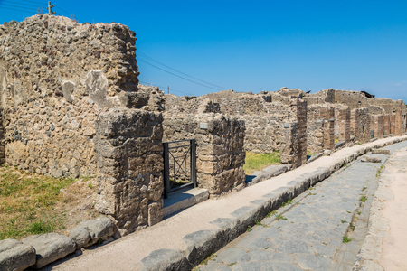 Pompeii city destroyed in 79BC by the eruption of volcano Vesuvius, Italy in a beautiful summer day Banco de Imagens