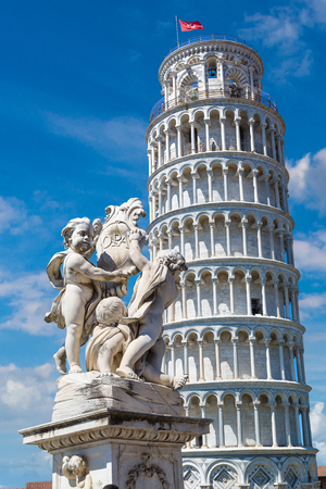 Leaning tower in Pisa with statue of angels, Italy in a beautiful summer day
