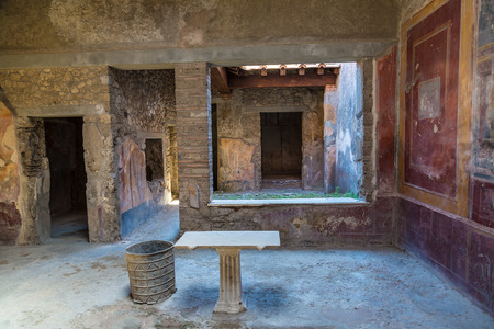 Living room in Pompeii city destroyed in 79BC by the eruption of volcano Vesuvius, Italy in a beautiful summer day Redakční