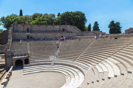Small Roman theater in the ancient city of Pompeii city destroyed in 79BC by the eruption of volcano Vesuvius, Italy in a beautiful summer day