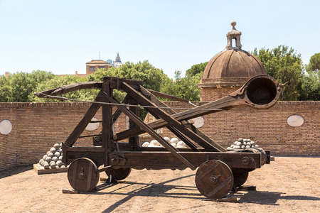castel: Old roman catapult in Castle Saint Angelo in Rome, Italy in a summer day