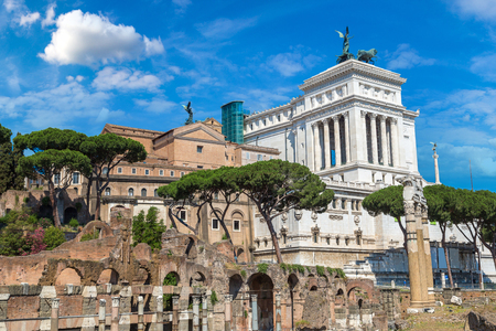 Ancient ruins of Forum and Victor Emmanuel II monument in a summer day in Rome, Italy