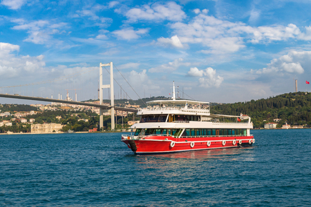 Passenger ship and Bosphorus Bridge in the Gulf of the Golden Horn in Istanbul, Turkey in a beautiful summer day