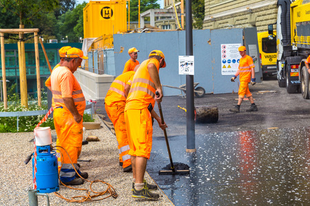 BERN, SWITZERLAND - JULY 25, 2017: Workers and vehicles during the asphalting in Bern in a beautiful summer day, Switzerland Editorial