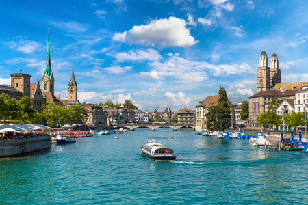 Historical part of Zurich with famous Fraumunster and Grossmunster churches in a beautiful summer day, Switzerland Editorial