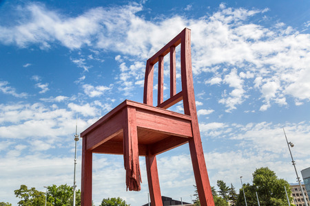 GENEVA, SWITZERLAND - JULY 25, 2017: Broken Chair on Square of Nations in Geneva in a beautiful summer day, Switzerland Editorial