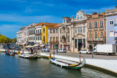 AVEIRO, PORTUGAL - JULY 25, 2017: Traditional boats on main city canal in Aveiro, Portugal in a beautiful summer day