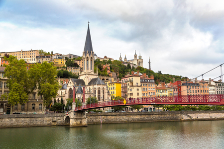 pedestrian bridges: Pedestrian Saint Georges footbridge and the Saint Georges church in Lyon, France in a beautiful summer day
