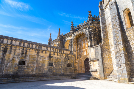 Manueline gate of the Convent of Christ in medieval Templar castle in Tomar in a beautiful summer day, Portugal