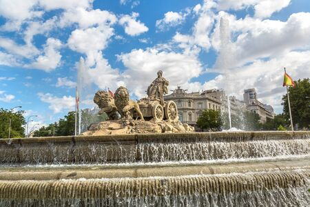 ancient lion: Cibeles fountain at Plaza de Cibeles in Madrid in a beautiful summer day, Spain