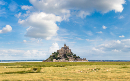 Panorama of Mont Saint Michele abbey in a beautiful summer day, France Stock Photo