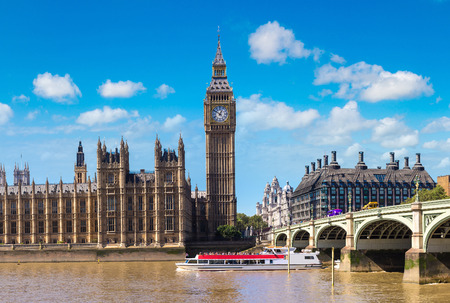 clock: The Big Ben, the Houses of Parliament and Westminster bridge in London in a beautiful summer day, England, United Kingdom Stock Photo