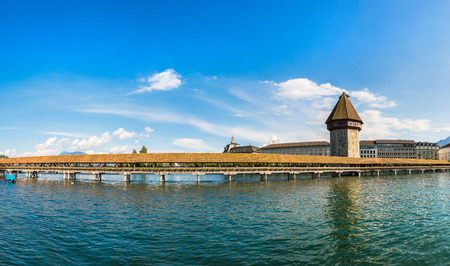 Panorama of Famous Chapel bridge in Lucerne in a beautiful summer day, Switzerland