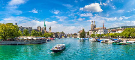 Historical part of Zurich with famous Fraumunster and Grossmunster churches in a beautiful summer day, Switzerland Stock Photo