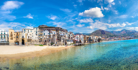Panorama of Harbor and old houses in Cefalu in Sicily, Italy in a beautiful summer day