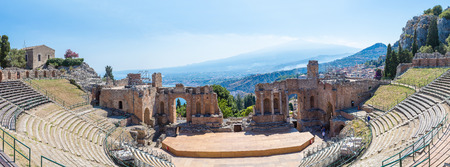 Ruins of the ancient Greek theater in Taormina, Sicily, Italy in a beautiful summer day Stock Photo