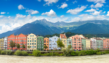 Building facade and Alps mountains behind in Innsbruck in a beautiful summer day, Austria