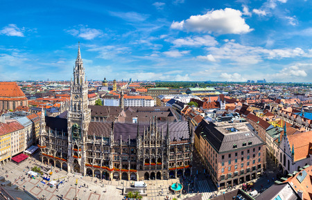 clock: Aerial view on Marienplatz town hall and Frauenkirche in Munich, Germany in a beautiful summer day