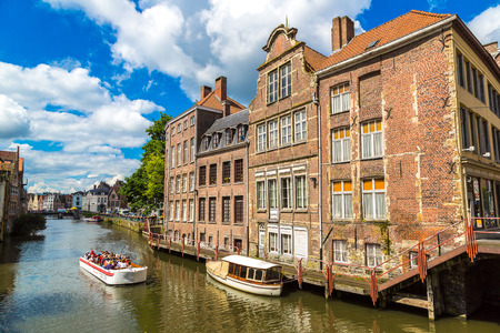 GENT, BELGIUM - JUNE 14, 2016: Canal in the old town in Gent in a beautiful summer day, Belgium on June 14, 2016