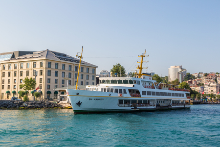 ISTANBUL, TURKEY - JULY 26, 2017: Passenger ship in the Gulf of the Golden Horn in Istanbul, Turkey in a beautiful summer day
